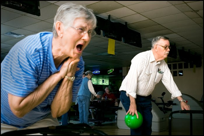 """We tied!"" yells 78-year-old Barbara Leastman to her friend Joann Gilbertson as Senior Center resident Dean Turley, 69, prepares to bowl in the background. ""I love these people,"" said Leastman. ""It's just like being in one big family."""